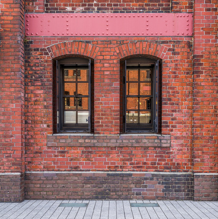 windows frame: Windows in a red brick wall background
