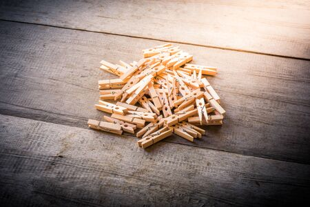 peg: Group of Clothes peg on wooden background Stock Photo