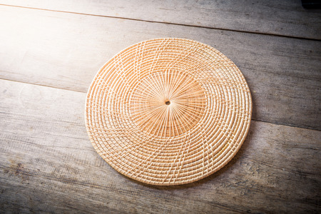 placemat: Wicker placemat on wooden background