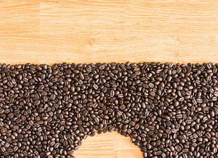 coffeetree: Coffee beans on wood background. used as a background