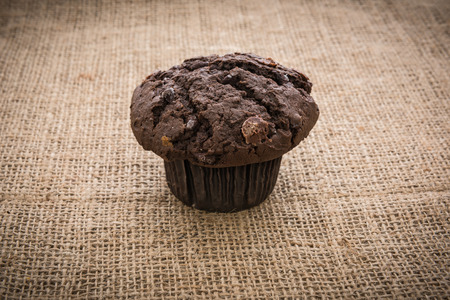 gunny: muffins on gunny  background in country style.