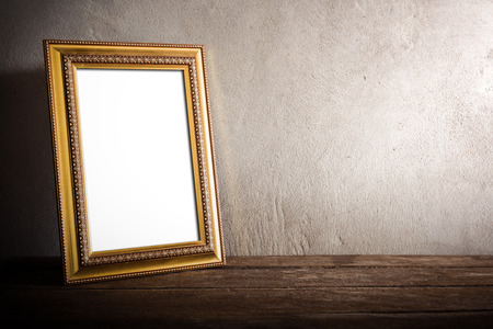 still life of luxurious photo frame on wooden table over grunge background. vintage tone Imagens