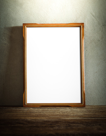photo pictures: still life of photo frame on wooden table over grunge background. vintage tone