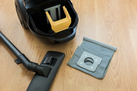 inside Vacuum cleaner and dust bag on the wooden floor Stok Fotoğraf - 41760533