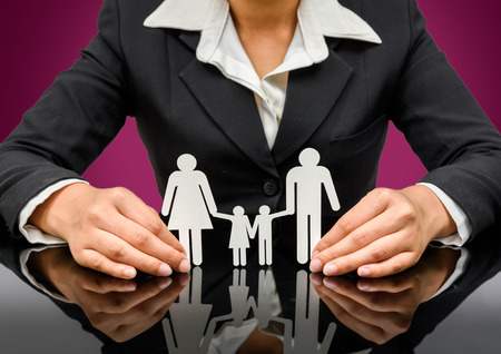 people, charity and care concept - close up of business woman hands holding paper family. isolated on white background with clipping path