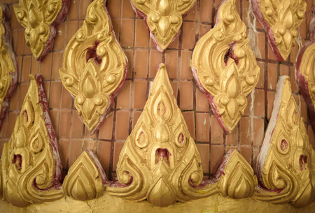 bas relief: Tha�lande ray� stuc bas relief au wat thai, la culture de la Tha�lande Banque d'images