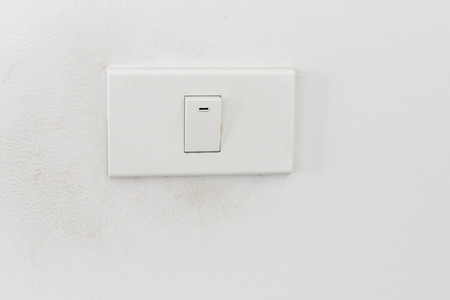 Light switch , White light switch on white wall , Concept , On Off