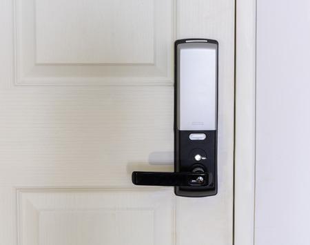 the lock: Electronic door lock on white wooden door