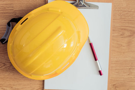 safety helmet, clipboard, notebook, pen on wooden table. top view. Construction concepts Stok Fotoğraf - 44634134