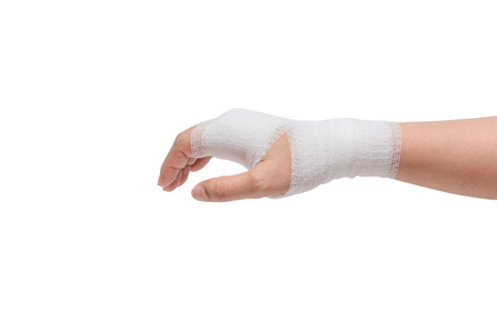 gauze: Injured painful hand with white gauze bandage. isolated on white background