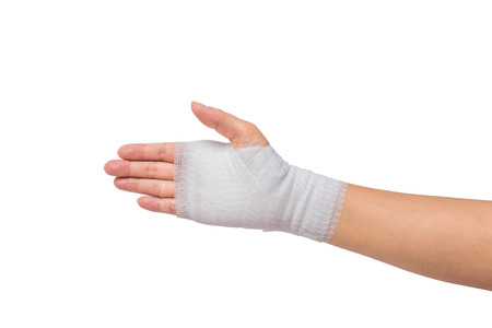gauze: Injured painful hand with white gauze bandage. isolated on white background with clipping path Stock Photo