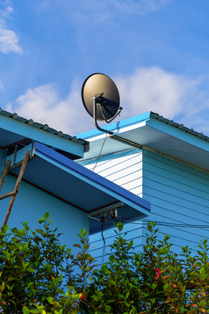 telecast: satelite dish is attached to the wall of the house Stock Photo
