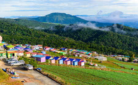 lodges: PHUTHAPBOEK PHETCHABUN THAILAND - OCTOBER 9 : Resorts and lodges on the mountain with sunset at morning from view point ,Phu Thap Boek,  OCTOBER 9, 2015 in PHETCHABUN THAILAND