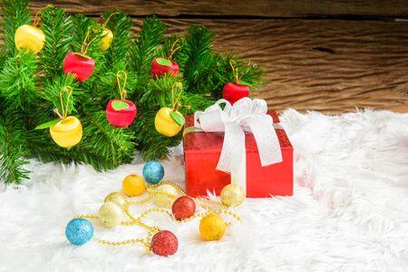 christmas tree presents: Gift box and Christmas tree ornaments. Christmas themes
