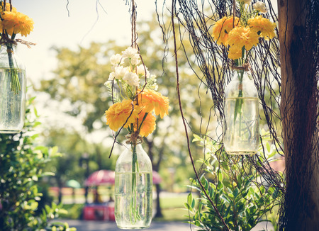The marigold flowers in a glass bottle hanging flower vase stock photo the marigold flowers in a glass bottle hanging flower vase arrangements mightylinksfo