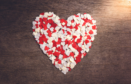 valentine day: A small heart-shaped paper Arranged a big heart. Valentine concept