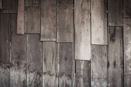 black textured background: rustic weathered barn wood background with knots and nail holes