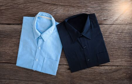 drycleaning: Black Shirt and Jeans shirt  on wooden background