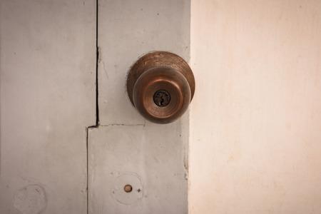 door knob: metal handle door knob on a old wooden door