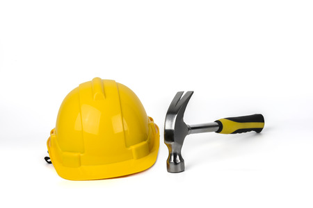 yellow hard hat: Yellow Hard Hat and Hammer Isolated on White background