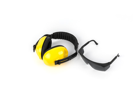 protective goggles: Protective ear muffs and Protective goggles Isolated on a white background