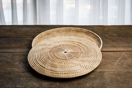 placemat: Wicker placemat on bamboo placemats and wooden background