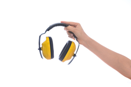hands over ears: hand hold Protective ear muffs Isolated on a white background