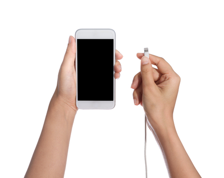 smart phone with blank screen and charger in hand isolated on white background