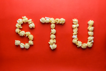 u s: popcorn forming letter S,T,U on red background