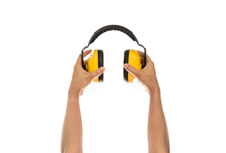 decibels: two hand hold Protective ear muffs Isolated on a white background Stock Photo