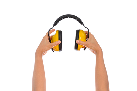 hands over ears: two hand hold Protective ear muffs Isolated on a white background Stock Photo