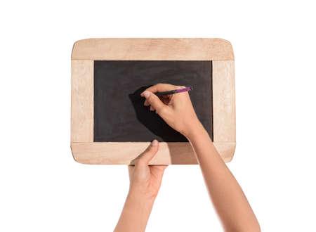 slate board: female hands holding slate board, blackboard and hand is Writing isolated on white background