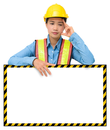 female worker with Protection Equipment, posing behind big white banner, scratching head, looking down and thinking and copy space, isolated on white background with clipping path