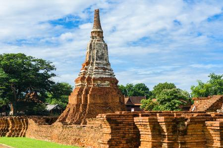 principal: Majestic ruins of 1629 Wat Chai Watthanaram built by King Prasat Tong with its principal Prang (center) representing Mount Meru, the abode of the gods in Ayutthaya, Thailand