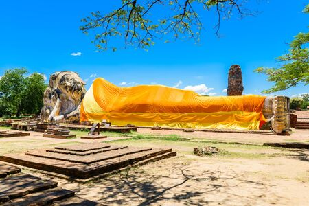 Principal Buddha statue , Reclining Buddha at Wat Lokayasutharam, Ayutthaya, Thailand. Ayutthaya Historical Park Stock Photo
