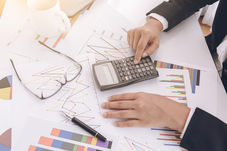 files and folders and businesswoman in background with calculator Stok Fotoğraf - 62285489