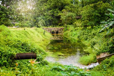 waterspout: Stone bridge and waterway in old mines at  pilok mines ,  Thongphaphum, Kanchanaburi, Thailand