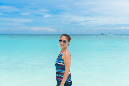 Woman standing in the turquoise water of the Similan Islands Stock Photo