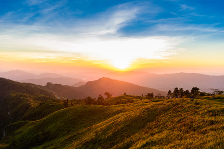 Sunset, View from phucheefa forest park mountain at Phucheefa,Chiangrai province ,North of Thailand.  THE PEAK OF MOUTAIN POINT TO THE SKY  Stock Photo