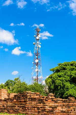 Telecommunication tower mast TV antennas wireless technology with blue sky Stock Photo