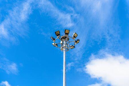 spotlight pole against blue sky and cloud Stock Photo