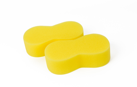 dirty car: yellow sponge for car washing isolated on white background