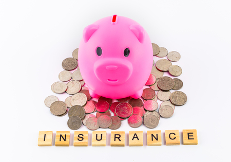 insurance text word made with wood blocks on stethoscope with piles of coins, piggy bank, saving for retire and doctor bills, medical fee