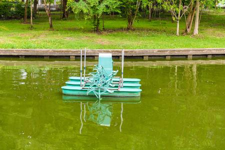 Water turbine, Aerator turbine wheel fill oxygen into water in lake Stock Photo