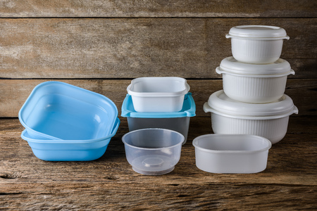 Set of Empty tupperware, containers for food on wooden table background