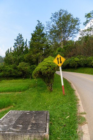 Trafic sign Two Way Traffic, The hill roads in garden the hills above the beautiful mountain. road up the mountain with dangerous curves