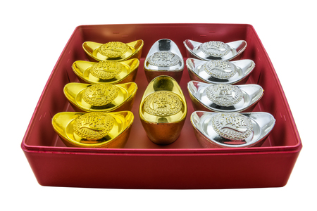 Chinese new year ornament Decoration of chinese gold ingots in red box isolated on white background with clipping path
