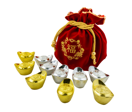 Chinese new year ornament Decoration of chinese gold ingots and Red fabric or silk  bag isolated on white background with clipping path Stock Photo