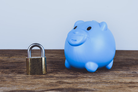 A pink piggybank and lock. Save Money Concept and used for financial protection inferences or other investment messages Stock Photo