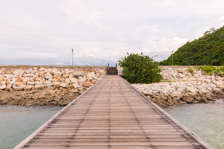 The wooden bridge in the sea at Khao Laem Ya-Mu Ko Samet National Park, Rayong, Thailand